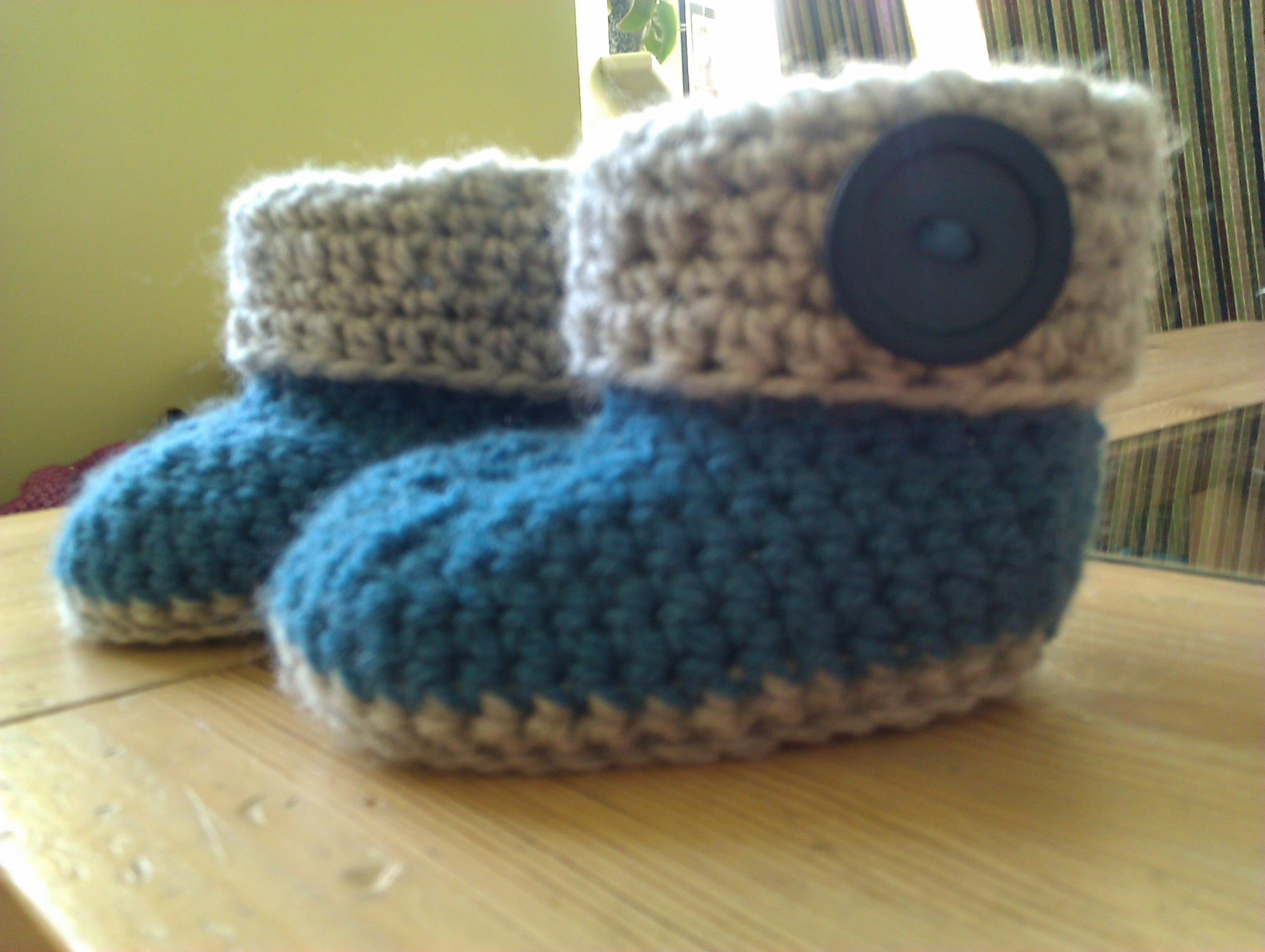 Hand crocheted, blue and grey booties.