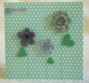 Hand made and hand stitched, green and grey crocheted flowers and green felt leaves greetings card. Left blank inside for your own message. Size w15.2 x h15.2cm