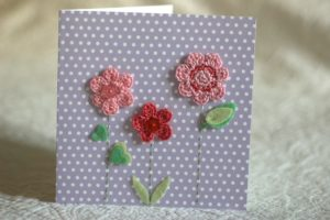Hand made and hand stitched, crocheted pink flower and felt green leaf greetings card. Left blank inside for your own message. Size w15.2 x h15.2cm. £4.50 (exc P+P)