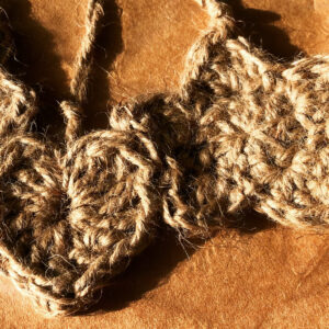 Handmade, crocheted, star and heart shaped hanging decorations made using 100% natural jute.