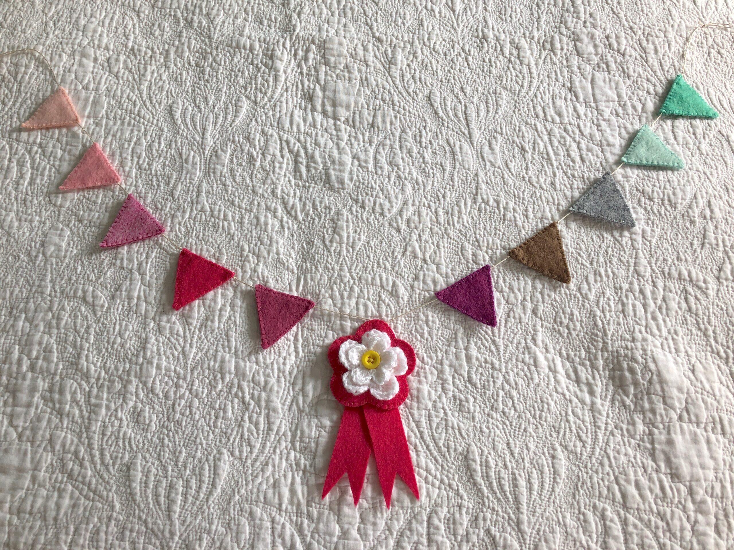 Felt bunting and crocheted flower rosette.