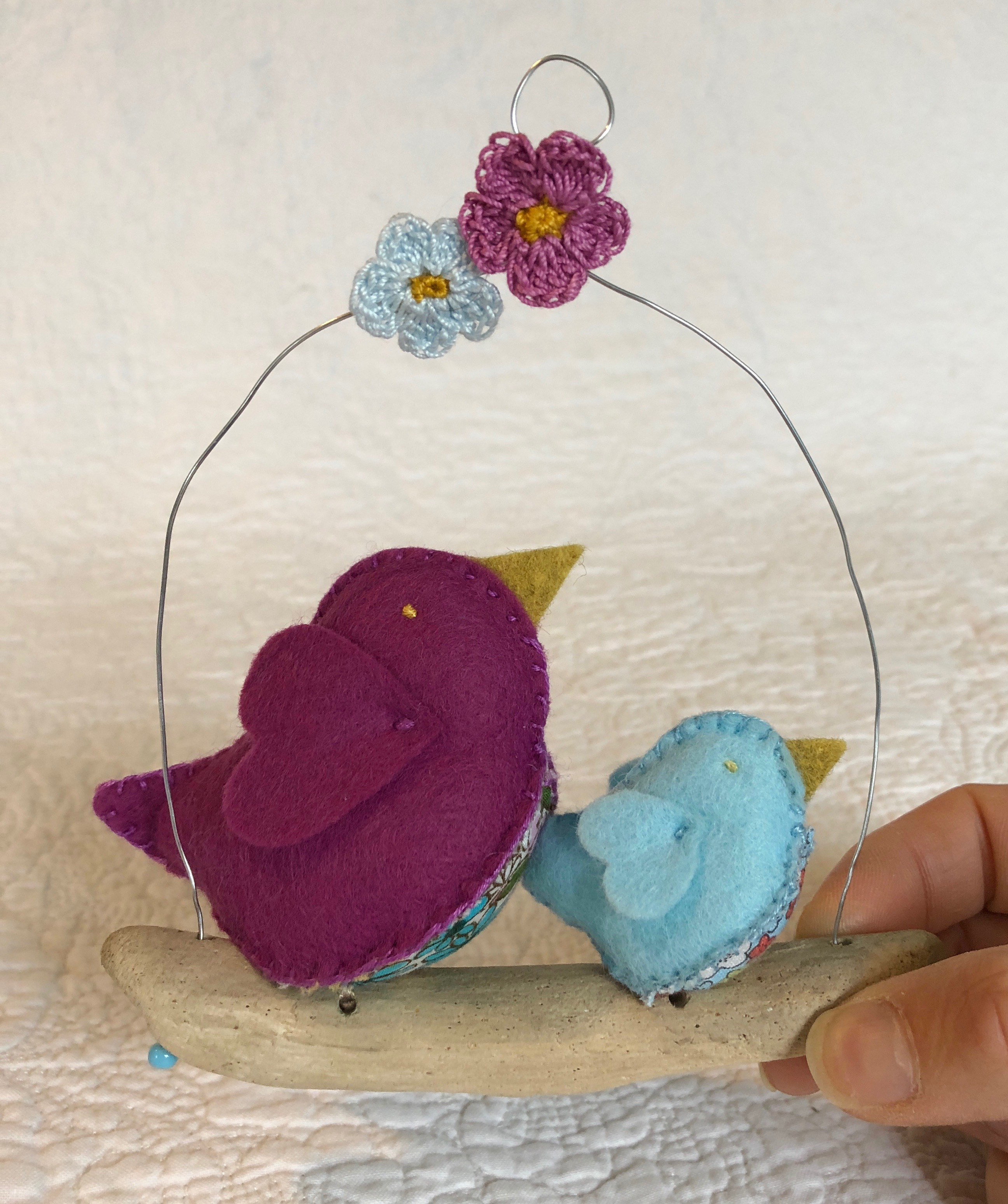 Hanging decoration. Hand sewn felt and floral cotton fabric little birds on a driftwood branch.