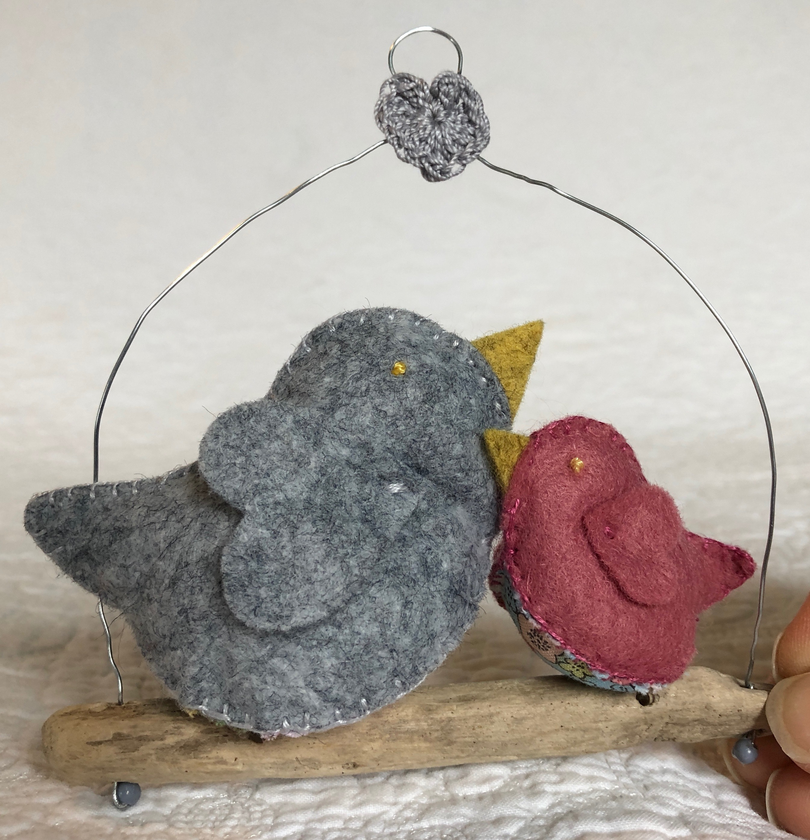 Hanging decoration. Hand sewn in grey and dusky pink felt and floral cotton fabric little birds on a driftwood branch.