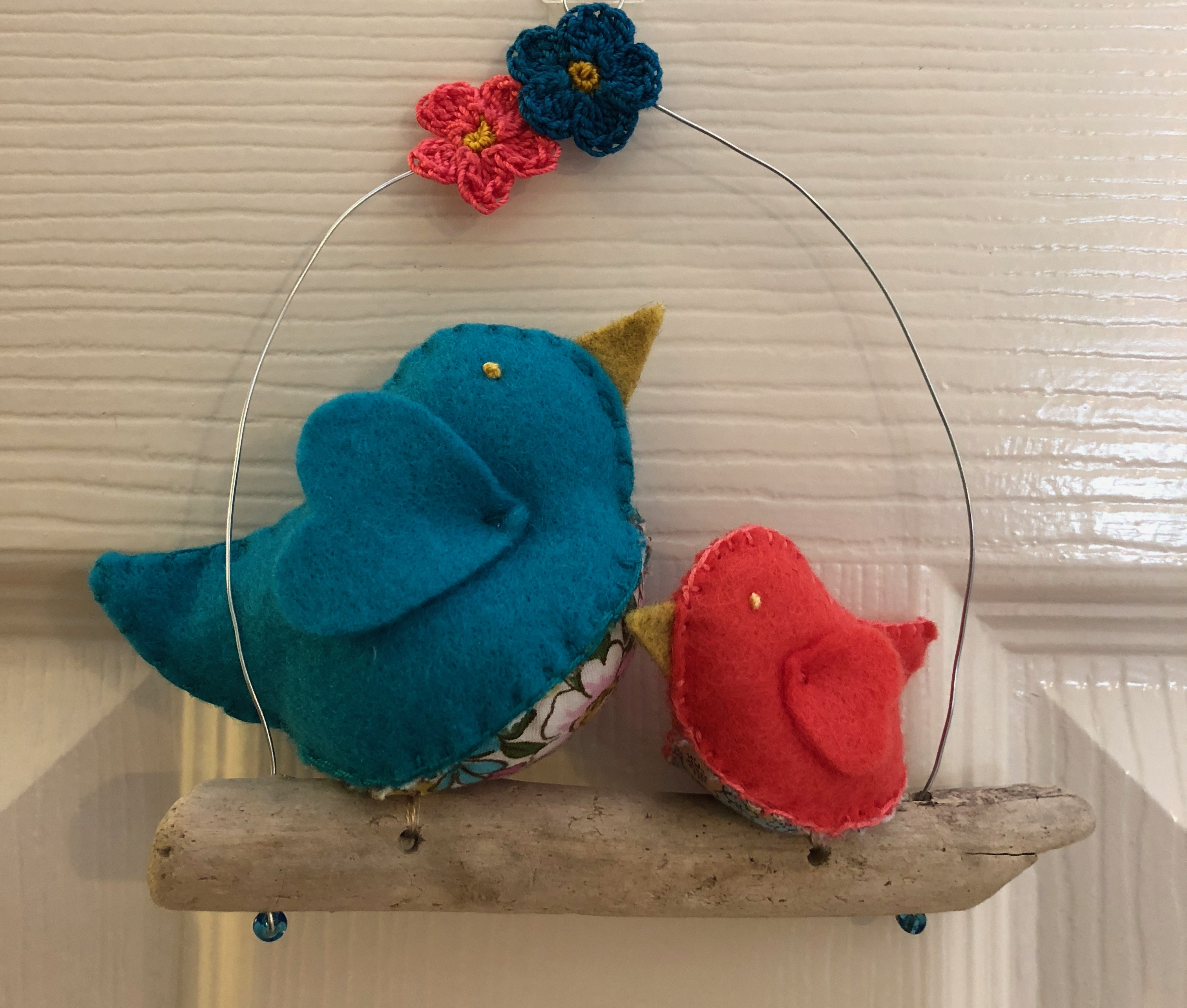 Hanging decoration. Hand sewn Turquoise and coral felt and floral cotton fabric little birds on a driftwood branch.