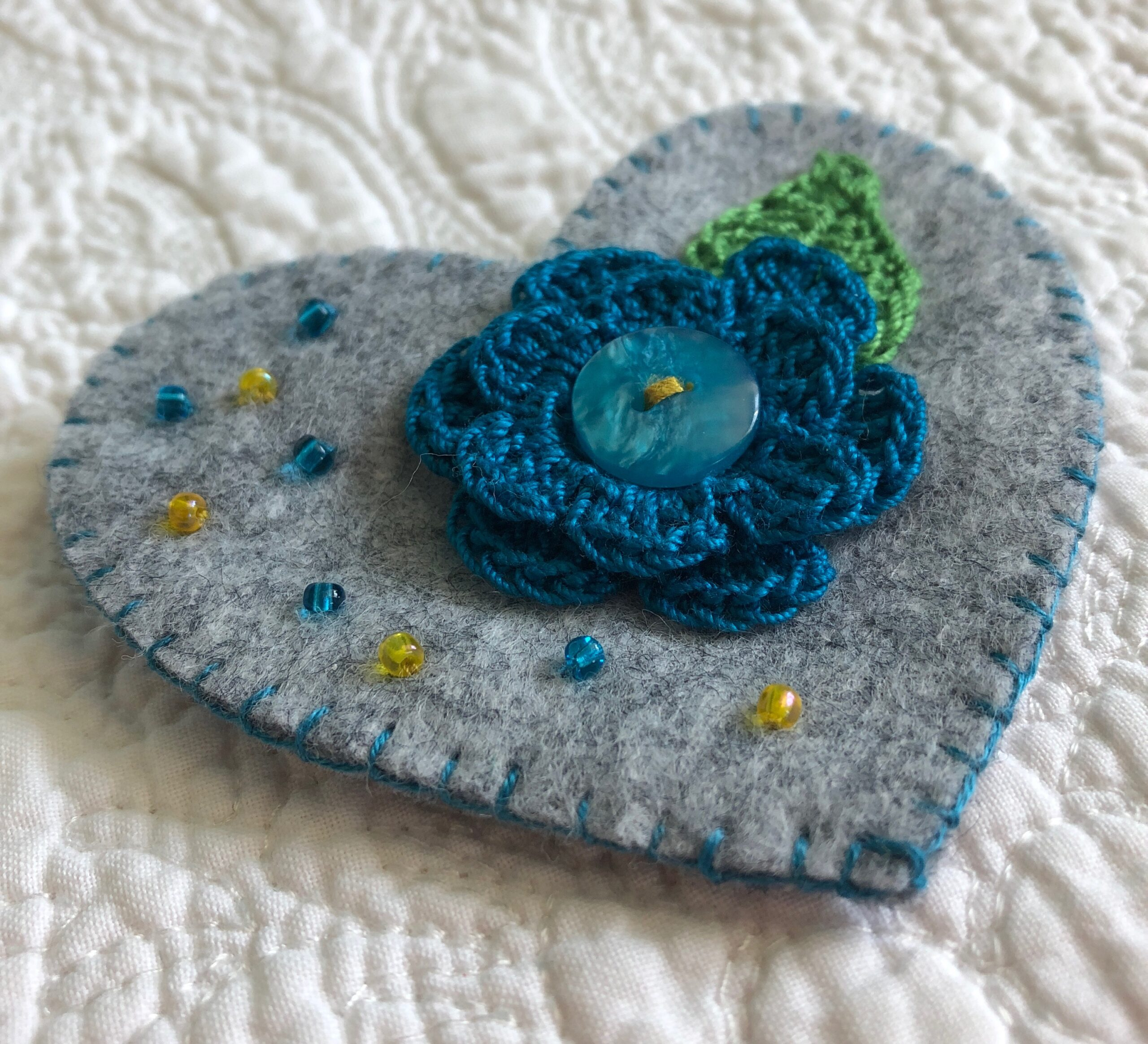 Hearts and flowers brooch.
