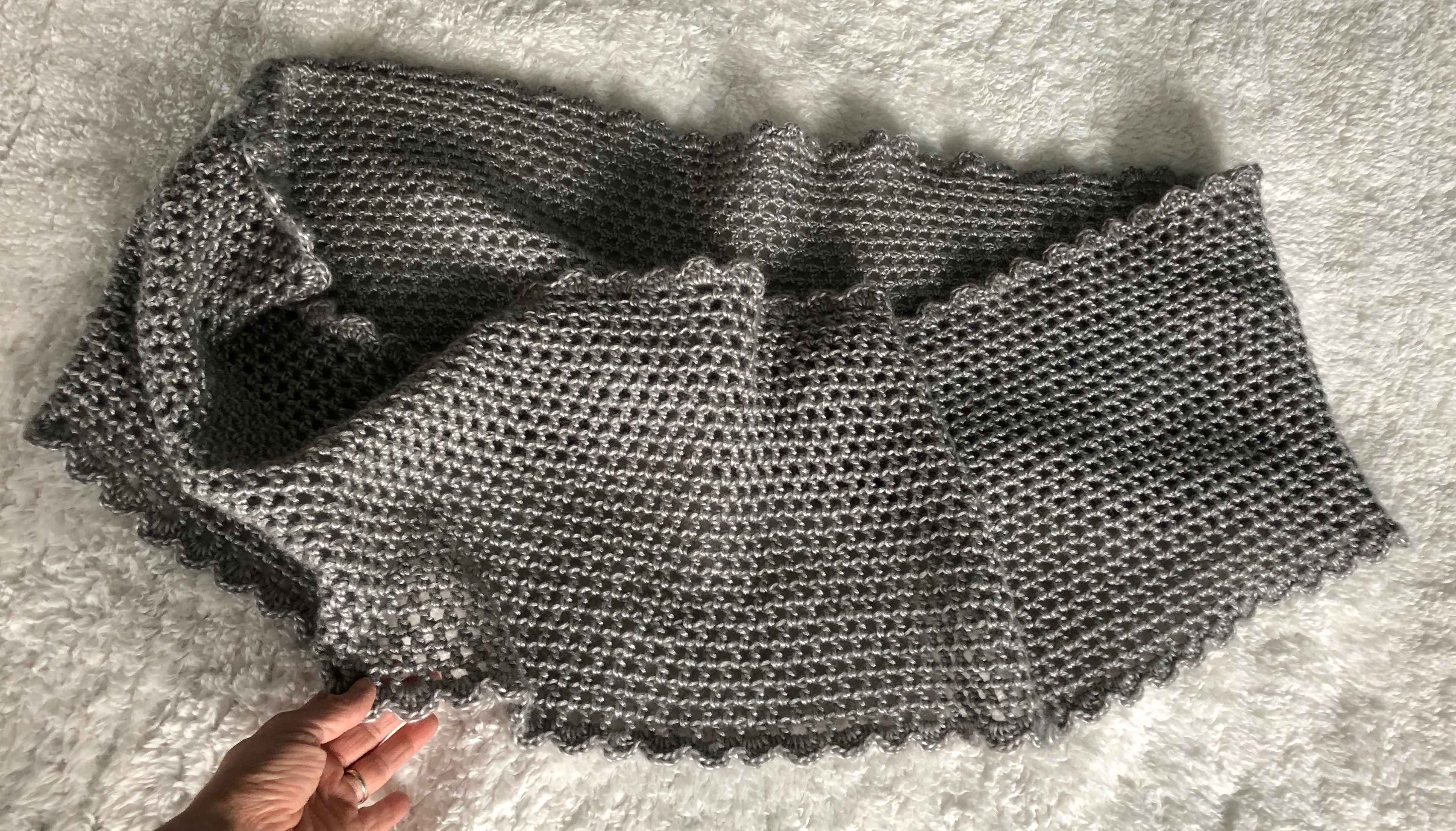 A soft pearl grey hand crocheted infinity scarf.