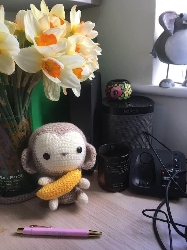 A little crocheted amigurumi monkey. Pattern by All About Ami.