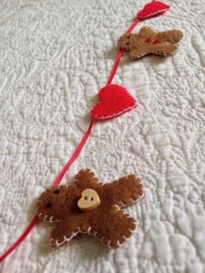 Mini felt gingerbread men and red hearts garland.