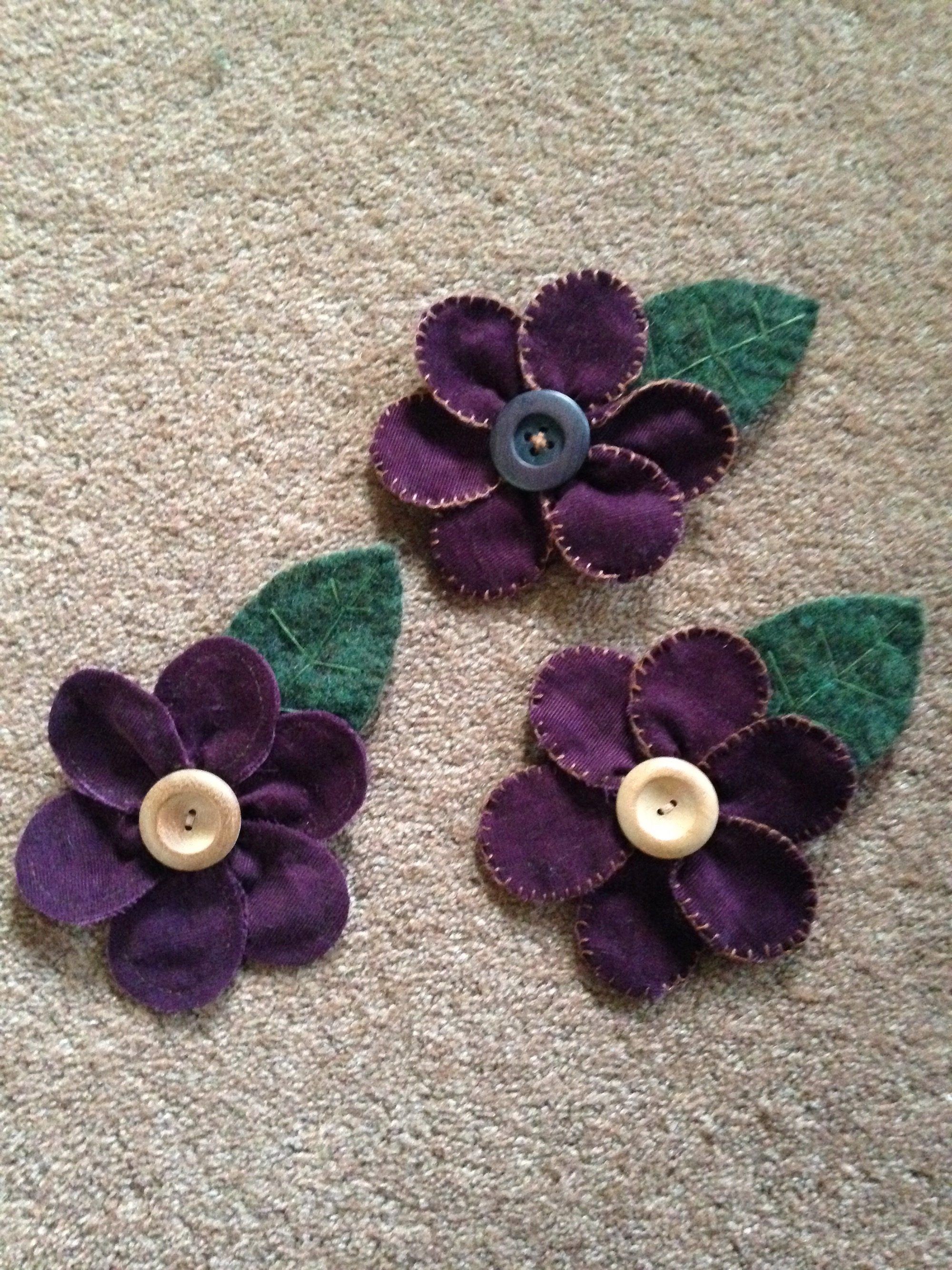 Memory flower brooches.