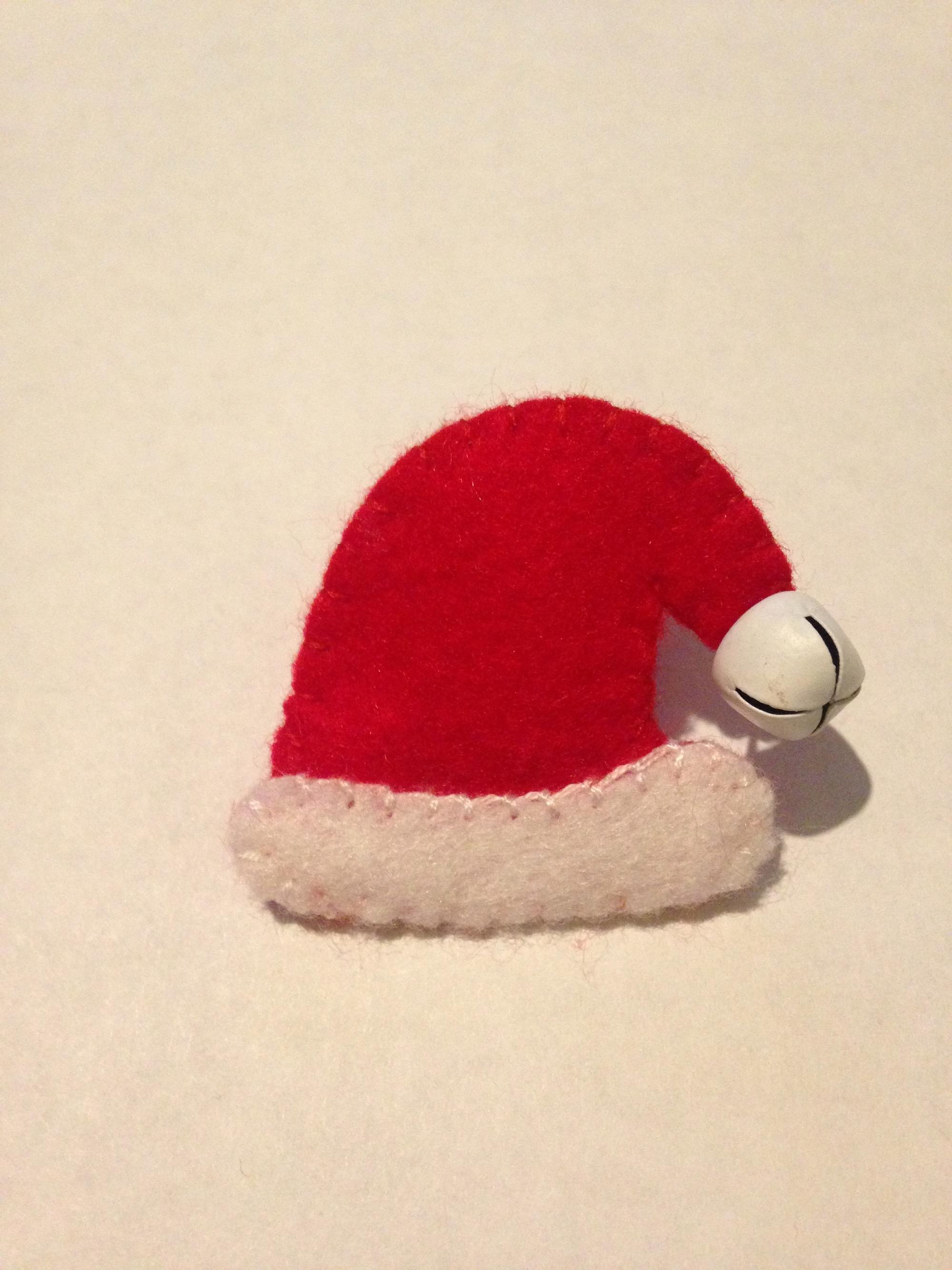 Santa hat brooch.