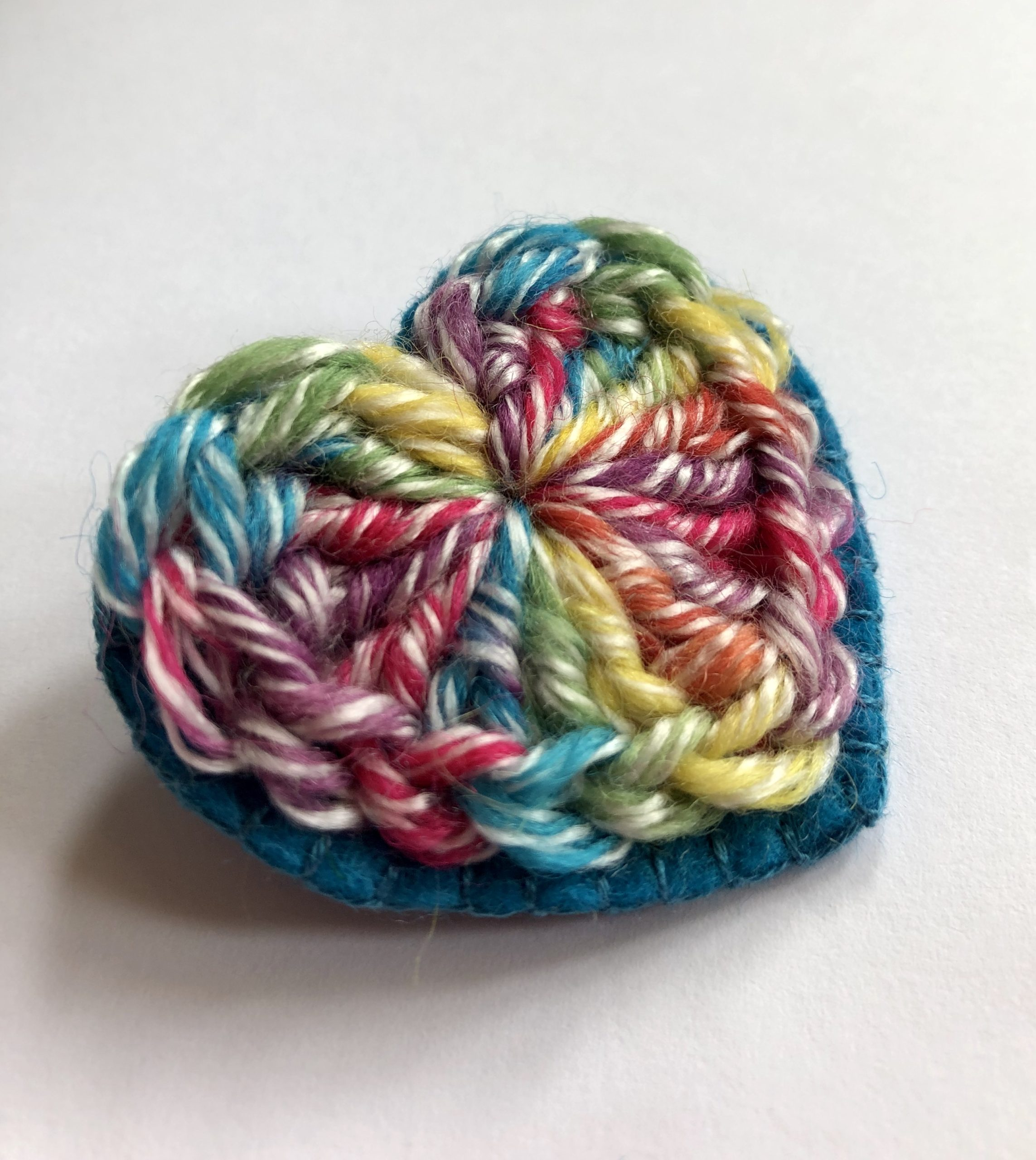 Rainbow heart brooch.