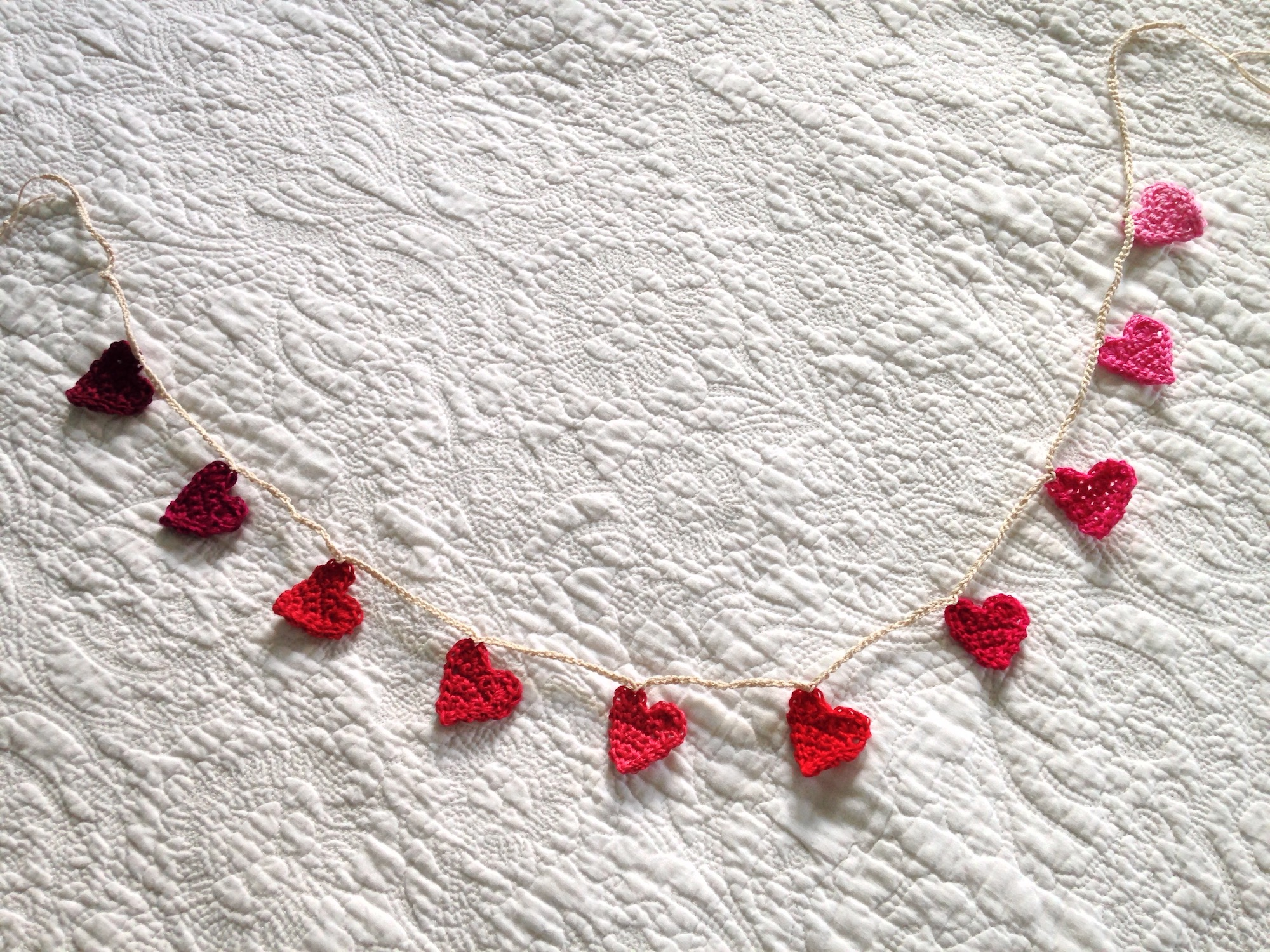 Tiny crocheted heart garland.