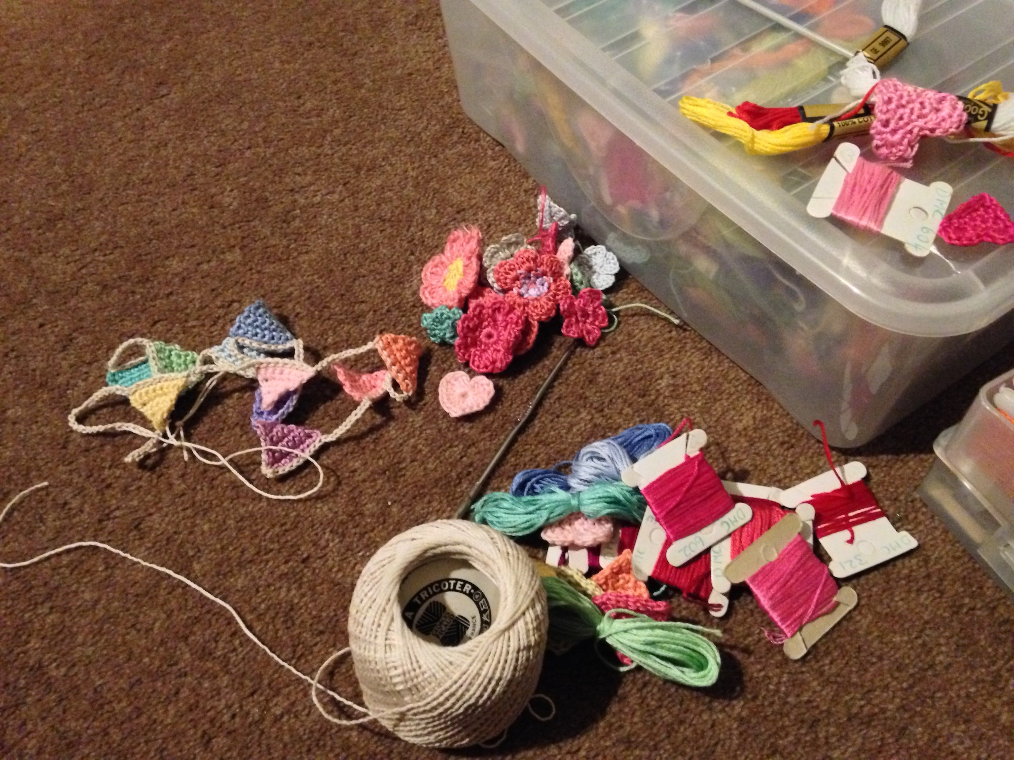 A selection of hearts, flowers and tiny hand crocheted items under construction.
