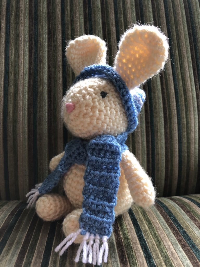 Hand crocheted bunny rabbit, with bobble hat and scarf.