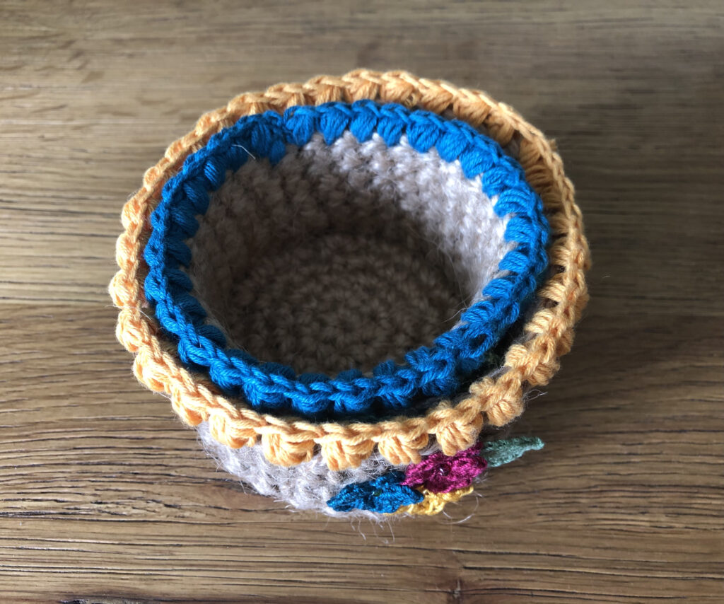 Handmade, crocheted 100% jute baskets. (Available in various sizes.) Decorated with 100% cotton crocheted flowers and leaves.