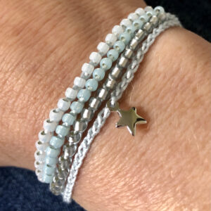 4 strand, fully adjustable bracelet with glass beads and silver metal coloured charm. Handmade using 100% cotton. Eco-friendly and fully recyclable.