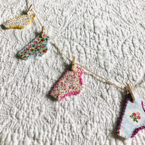 A handmade garland of positive pants. Made with fabric and felt and held with mini wooden pegs on a cotton line. Approximate length 90cm.