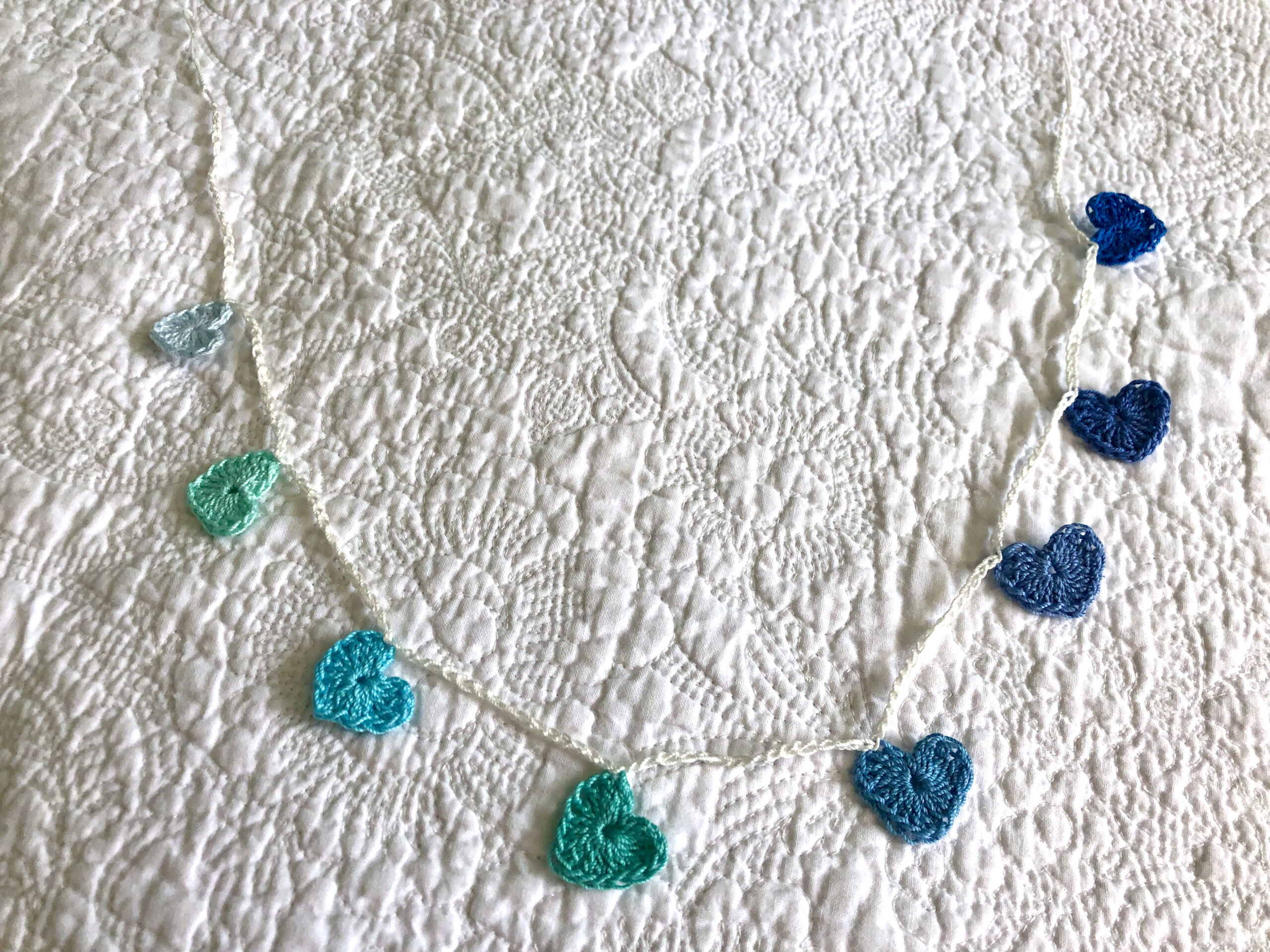 Tiny hearts garland in blues and greens.