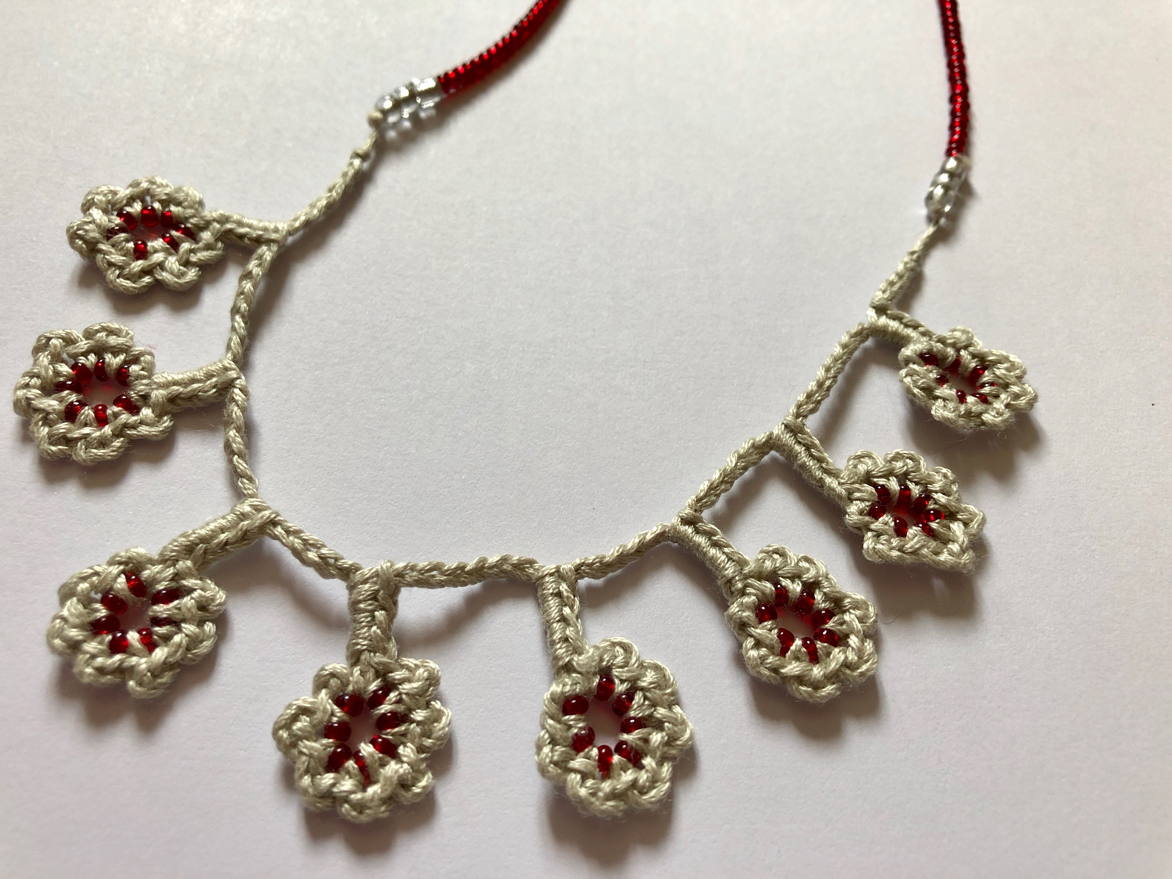 Crocheted and beaded flower necklace.